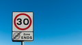 Sign maximum speed zone ends on the blue sky background Stock Photo