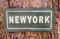 Sign of newyork text plate on tree background Stock Photography