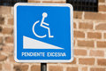Sign of notice for handicapped persons excessive slope spain Royalty Free Stock Photography