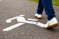 Sign of pedestrian zone on sidewalk white asphalted and feet in summertime Stock Photography
