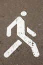 Sign of pedestrian zone on sidewalk white asphalted in summertime close up view Stock Images