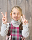 Sign positive girl showing thumbs up victory Stock Photo