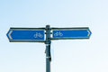 Sign posts for bicycle path blue post directions Stock Images
