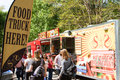 Sign promotes presence of food trucks at atlanta festival ga usa april a announces the to a crowd attending the o rama in grant Royalty Free Stock Photo