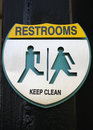 Sign of public restroom silver metallic plate Stock Photos