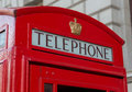 Sign on red telephone booth a classic in london england Royalty Free Stock Photo