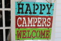 Sign saying happy campers welcome