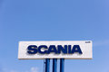 Sign Scania against blue sky. Royalty Free Stock Photo