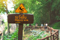 Sign showing a slippery area. Royalty Free Stock Photo