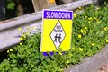 Sign slow down kids playing Royalty Free Stock Photo