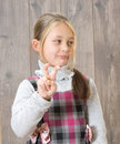 Sign smiling girl showing thumbs up rabbit ears Royalty Free Stock Image