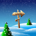 Sign in snowy landscapae illustration of wooden pointing towards snowing winters landscape Royalty Free Stock Photo