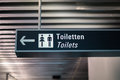 Sign for toilets restroom in airport in german and english an international Stock Image