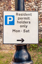 Sign warning motorists residents permit holders only this car parking space is Royalty Free Stock Image