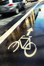 Sign of the water cycle paths on the street in the reflection of Royalty Free Stock Photo