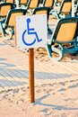 Sign wheelchair set on the beach by sea Royalty Free Stock Photos