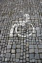 Sign of wheelchair users on stone pavement Royalty Free Stock Photo