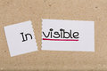 Sign with word invisible turned into visible