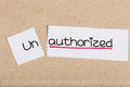 Sign with word unauthorized turned into authorized two pieces of white paper the Stock Photo