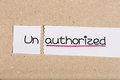 Sign with word unauthorized turned into authorized two pieces of white paper the Stock Images