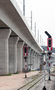 Signal pole of eastern railway line under the high speed train bridge to the airport thailand Stock Photos