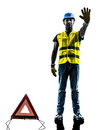 Signals safety warning triangle man stop gesture one with vest silhouette isolated in white background Stock Images