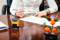 Signature document businesswoman working at her office Royalty Free Stock Photo