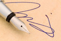 Signature and fountain pen a a on yellow paper symbolic photo for contract testament graphology Royalty Free Stock Photography