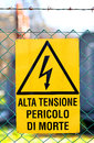 Signboard of danger high voltage in power plant yellow electricity production Royalty Free Stock Photography