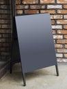 Signboard stand blank menu shop restaurant with brick wall black Stock Photos