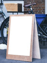 Signboard stand Mock up Poster Frame Flea market shop front Royalty Free Stock Photo