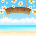 Signboard Welcome anf flowers on tropical beach Royalty Free Stock Photography