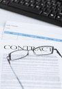Signed contract paper with glasses Royalty Free Stock Photo