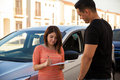Signing a car lease pretty young women new with salesperson Stock Images