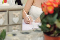 Signing certificate at ceremony bride marriage with white pen Royalty Free Stock Photography