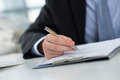 Signing a contract cropped image of businessperson on the foreground Royalty Free Stock Image
