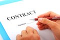 Signing contract hand with red pen and Royalty Free Stock Image