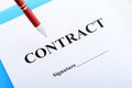 Signing contract red pen and on table Royalty Free Stock Photography