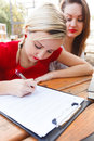 Signing a model release blond girl in red contract Royalty Free Stock Photography