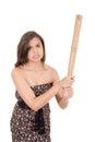 Signora graziosa con una mazza da baseball isolata su bianco Fotografia Stock