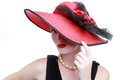 Signora wearing red hat su fondo bianco Immagine Stock Libera da Diritti