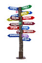 Signpost with directions to travel destinations colorful isolated on white background Royalty Free Stock Photography