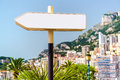 Signpost in monaco and beautiful panoramic view of on background Royalty Free Stock Photo