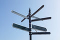 Signpost Pointing In Many Directions Against Blue Sky Royalty Free Stock Photo