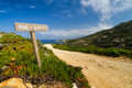 Signpost pointing to the beach at La Revellata in Corsica Royalty Free Stock Photo