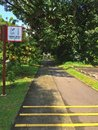 Signpost shared track please keep left reminding pedestrians and cyclists to travel safely in bukit batok park connector network Royalty Free Stock Photography