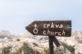 Signpost to church on sv jure peak in biokovo mountains Stock Photo
