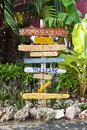 Signpost at tropical resort made of flotsam showing directions to facilities beach Stock Images