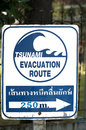 Signpost of a tsunami shelter pointing to nai harn beach phuket thailand Royalty Free Stock Photography