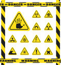 Signs of chemical effects on human, radiation, radiation and explosives in the yellow triangles. Caution. Vector Royalty Free Stock Photo